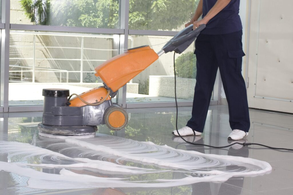 a cleaner polishing/cleaning the floor