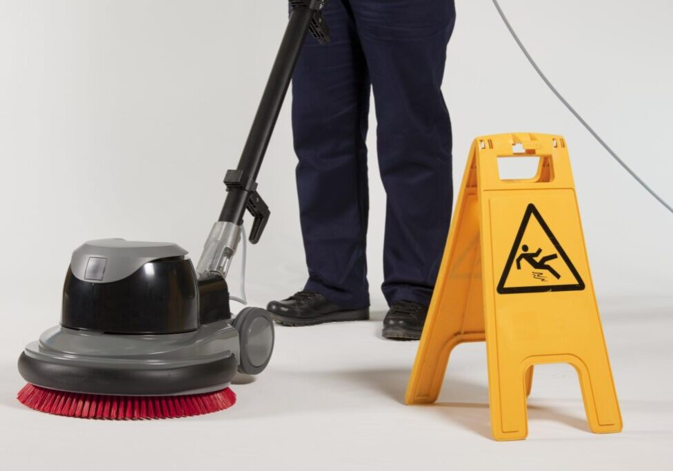 cleaning the floor and a caution that the floor is slippery